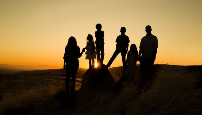 Silhouette of a family in a sunset background