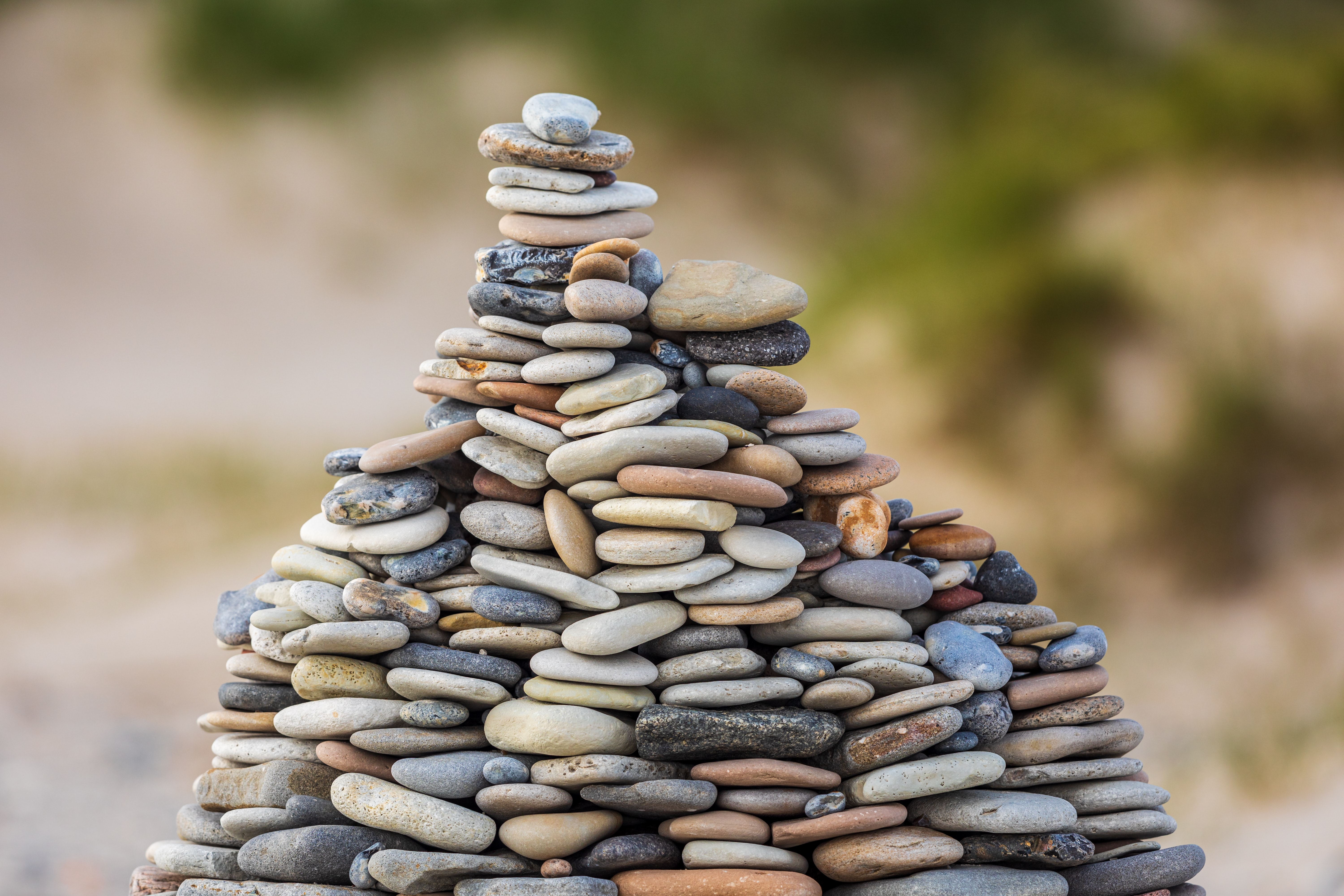 Pile of stones balancing each other, showing the benefits of Trust