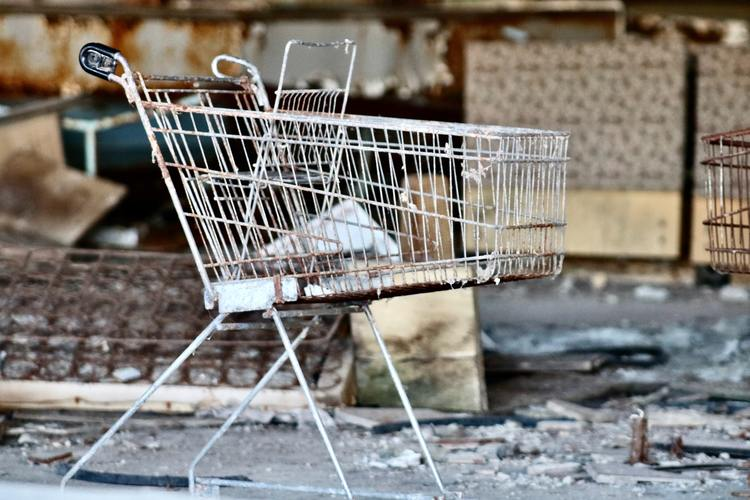 A deserted shopping cart in a destroyed area, showing relationship between terrorism and economic growth