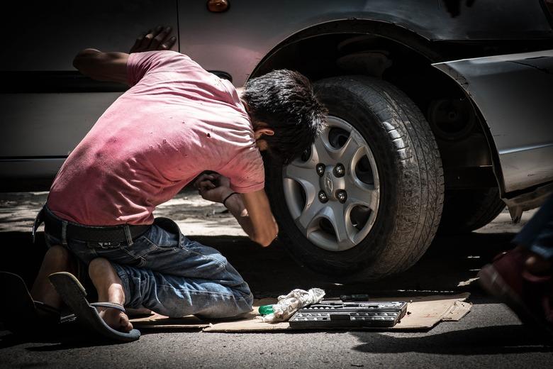 child labor in car mechanic shop