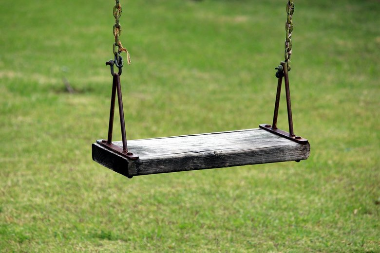 An empty swing, child labor snatches right to play and learn from children